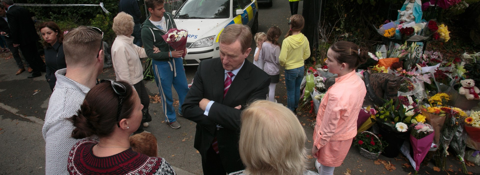 11/10/2015 Taosieach Enda Kenny TD speaking to members of the public at the scene of a fire which resulted in the deaths of 10 people at a halting site on Glenamuck Road South, Carrickmines , Dublin. Photo: Gareth Chaney Collins