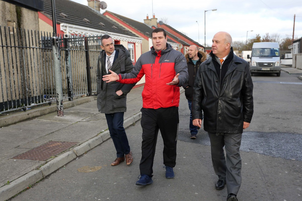 Council of Europe Commissioner for Human Rights Nils Muiznieks visits Cara Park,  Coolock and walks past an abandoned training centre - a casualty of the recession explains Michael Collins. ©Photo by Derek Speirs.