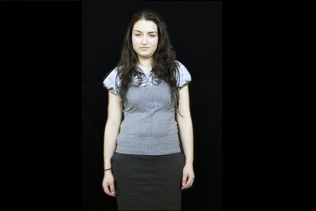 My name is Gina. I was born in Romania. I've been in Ireland for sixteen years. I am training to be a nurse so I can help people. I am proud to be Roma because our ancestors have made a name in this world. Our Roma ancestors have done some great things in their time and I would love to make a difference in the world of today to show there is more to us Roma. We can achieve great things and make a change for the future.  There's more to a book than just the cover! ©Photo by Alison McDonnell