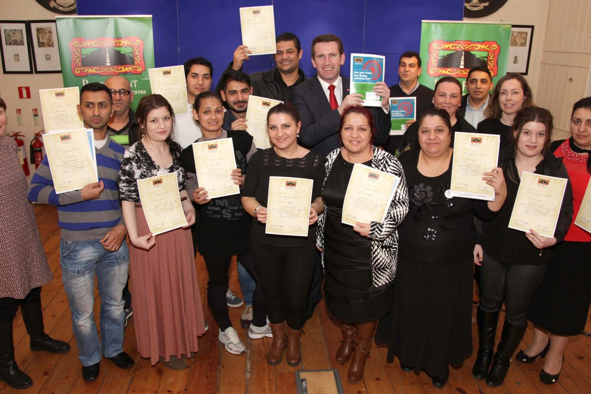 Minister Aodhan O'Riordain TD presenting training certificates to Roma peer researchers. ©Photo by Derek Speirs