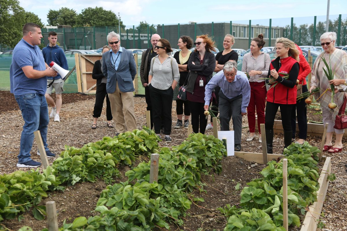 Community Hearts Day event at Abigail Centre, Finglas, organised by Pavee Point Traveller and Roma Centre, supported by Irish Heart and CDETB. Here Michael Collins, Mens Development Worker, Pavee Point conducts a tour of the garden. ©Photo by Derek Speirs.