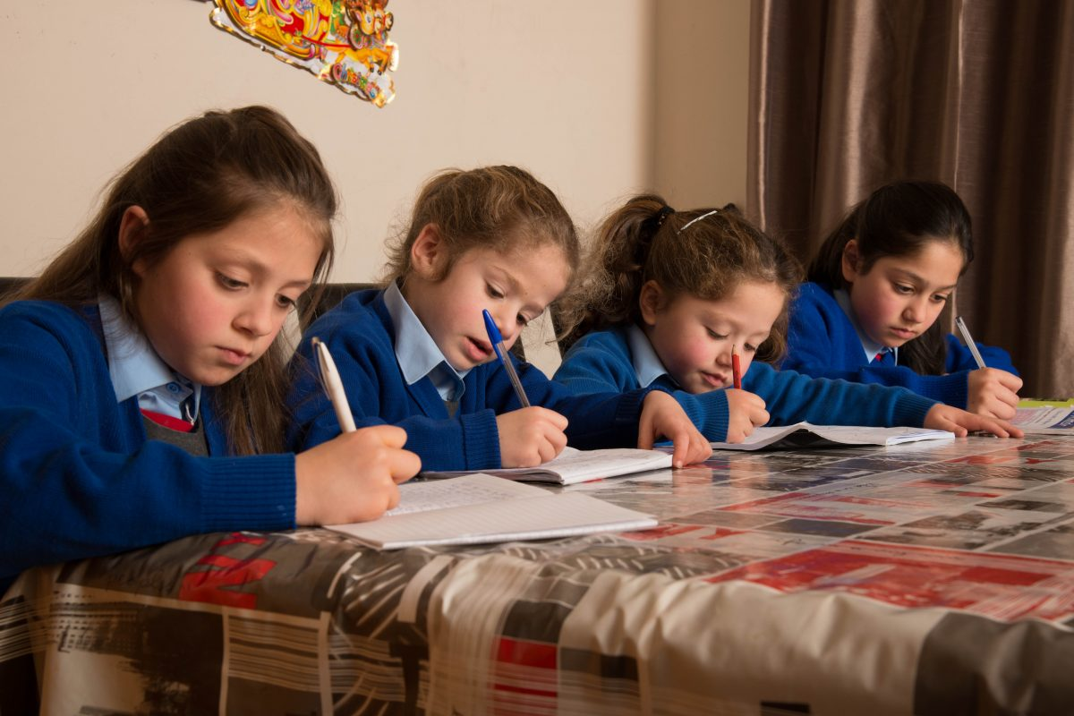 Roma children doing their homework ©Photo by James Fraher