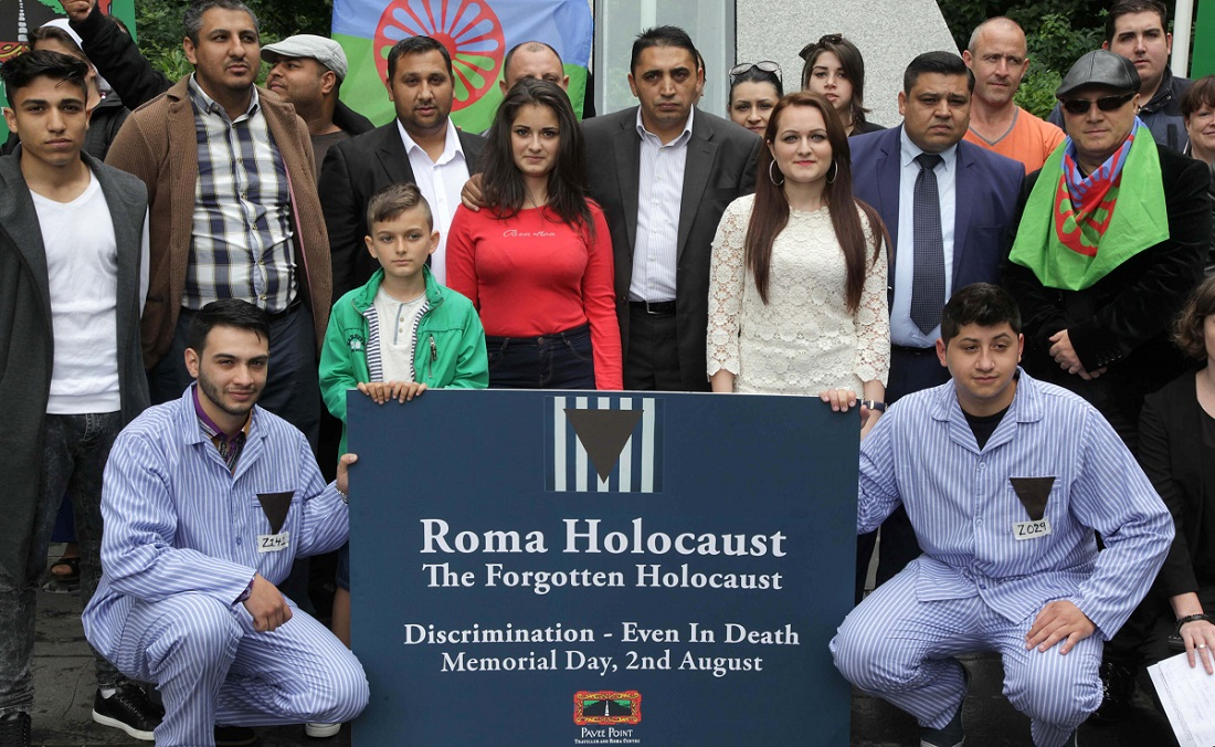 Roma Holocaust Memorial Day. Pictured left to right Manu Paun and Ricardo Munteanu, in the foreground, with other members of the Roma community. This day marks the day in 1944 when 2,897 Roma and Sinti were murdered in the gas chambers of Auschwitz. ©Photo by Derek Speirs